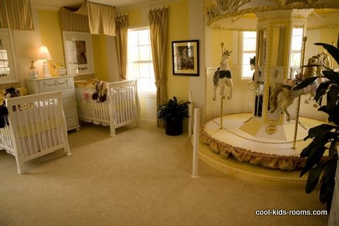 Luxury beige and yellow colored nursery for twins with carousel