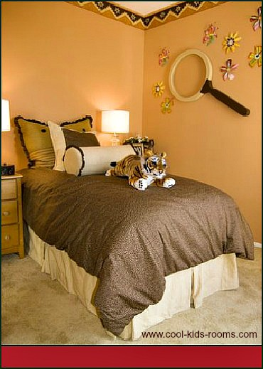 Bedroom with wallpaper border and wall stickers