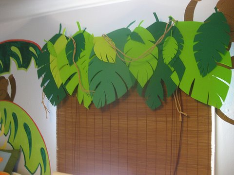 Window treatment with shades and leaves for jungle themed bedroom